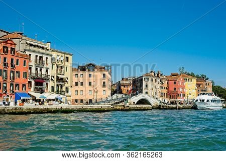 Venice, Italy - June 2, 2019: Brightly Colored Buildings Line The Eastern End Of The Grand Canal, Wh
