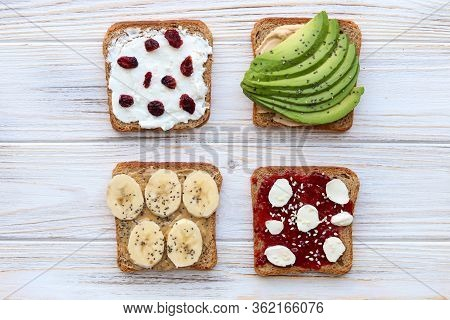 Top View Of Wholegrain Bread Toast, Avocado Toast, Peanut Paste Toast, Raspberry Jam Toast