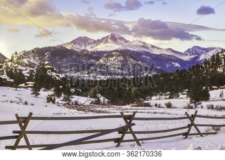 The Summit Of Longs Peak Glows At Sunrise After A Fresh Snowfall In Estes Park Colorado
