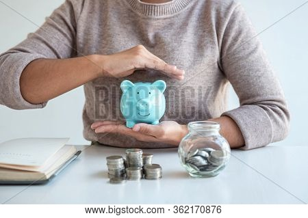 Young Woman Hands Protection Piggy Bank And Planning Growing Saving To Strategy With Pile Coins For
