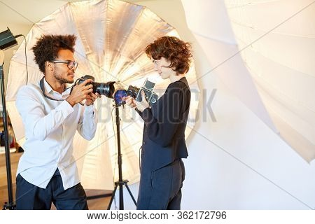 Photo students with two different cameras for portrait photography