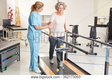 Woman with handicap while training on treadmill in physiotherapy
