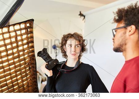 Photographer and photo assistant discuss and plan a photo shoot