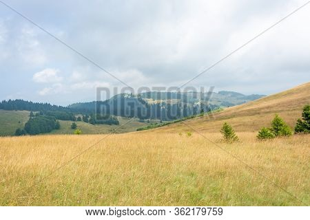 Hill Slopes And Cloudy Sky