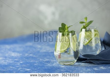 Two Detox Water Or Martini Tonic Cocktail With Kiwi, Lime, Ice And Mint. A New Kind Of Mojito With K