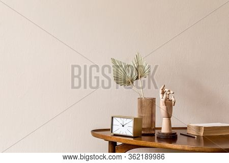 Stylish Composition On The Design Wooden Table With Gold Clock, Wooden Hand And Paper Flowers In Vas