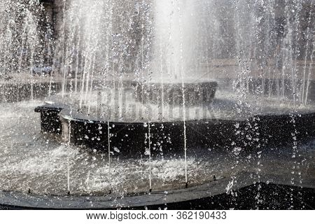 Splash And Drops In A Spring Fontain. Water Falling, Close Up Shot. Fontain Water Details.
