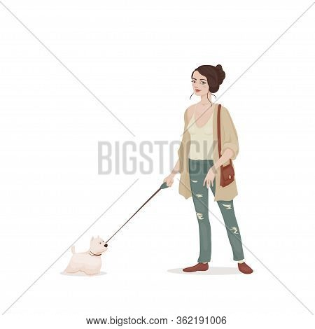 Young Woman With Brown Hair In A Beige Cardigan And Jeans With A Small White Leash Dog. Doggie Walki