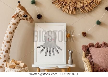 Stylish And Modern Scandinavian Newborn Baby Interior With Mock Up Photo Frame On The Small Table. T