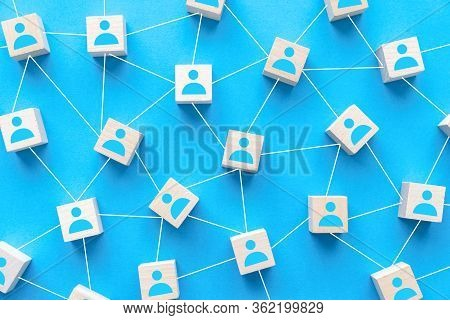 Seamless Social Network Or Connecting People Concept Using Wood Square Block On Blue Background
