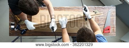 Top View Of Male Carpenters Putting Wooden Block In Vise. Joiners Using Special Carpentry Tools For