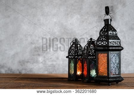 On Table Top Image Of Decorations Ramadan Kareem Holiday Background.close Up Arabic Lantern Metal On