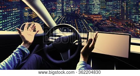 Person Using A Car In Autopilot Mode Hands Free