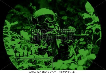 Portrait Of A Commando In The Night Sight Of A Sniper Rifle. The Concept Of Military Operations, Int
