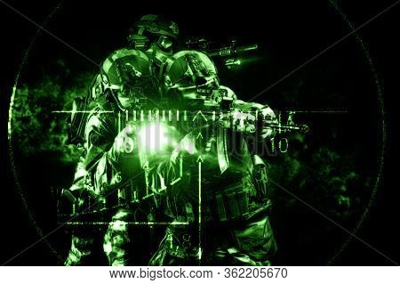 Portrait Of A Group Of Commandos In The Night Sight Of A Sniper Rifle. The Concept Of Military Opera
