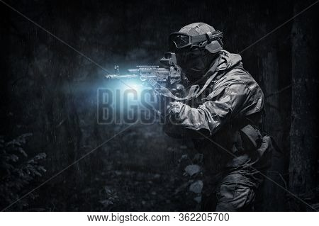 Portrait Of A Commando In The Forest. The Concept Of Military Operations, International Conflicts, S