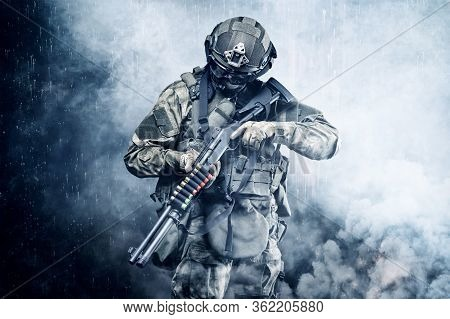 Portrait Of A Special Forces Soldier Who Is Aiming At A Collimator Sight Of A Machine Gun. The Conce