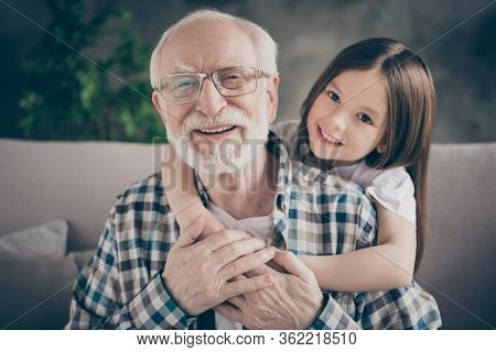 Closeup Photo Of Funny Two People Old Grandpa Little Granddaughter Sitting Sofa Stay Home Quarantine