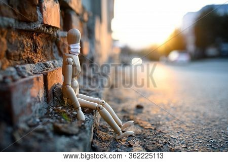 Sad And Tired Wooden Mannequin In Town, Corona Virus And Lockdown Concept.