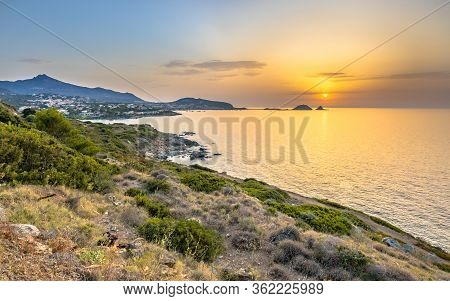 Golden Sunset Over Rugged East Coast Of Corsica With View Over Ile Rousse, France
