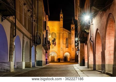 Piazza Risorgimento And Via Cavour, Main Square Of Alba (piedmont, Italy) At Night With The Facade O