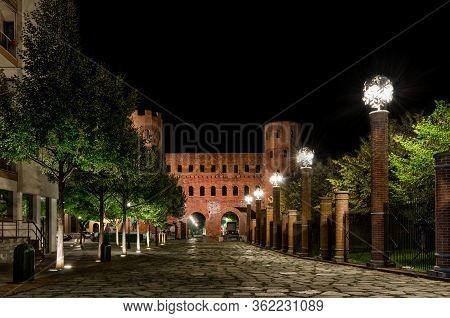 Remains Of The Palatina Gate, Ancient Entrance Of Turin (italy) At Night. The Palatina Gate Was Buil
