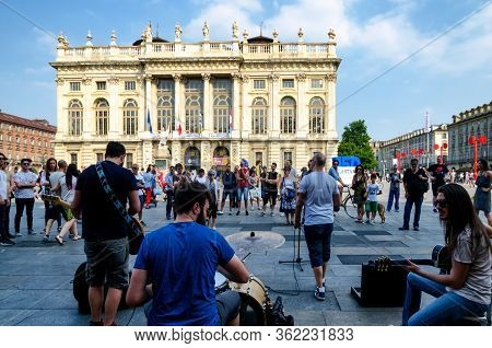 Turin, Italy - Juny 11, 2017: Street Band Playng Music In The Center Of Piazza Castello, Main Square