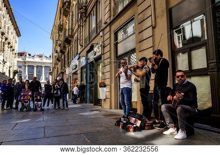 Turin, Italy - May 7, 2017: Street Band Playng Music In The Center Of Via Garibaldi, Main Shopping S