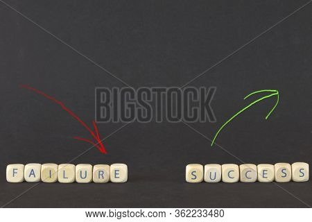 Failure And Success. Business Concept. The Words Failure Or Success On Wooden Cubes. Color Arrows Po