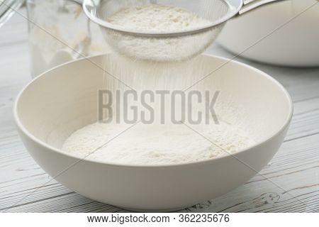 Flour Sifting Through A Sieve For A Baking