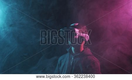 Portrait Of A Man In Virtual Reality Helmet. Obscured Dark Face In Vr Goggles. Internet, Darknet, Ga