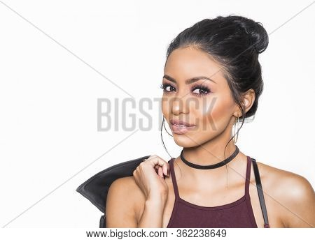 Beautiful woman with sultry makeup and hair pulled back isolated against white background