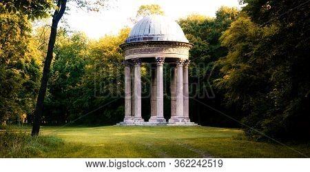 Classical Concordia Temple In The Landscape Gardens Of Franzensburg, Laxenburg Castle Near Vienna, A