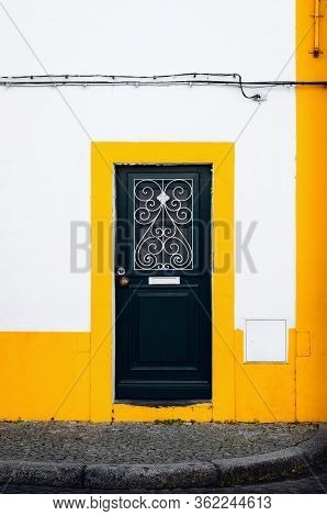 A Traditional Door In Evora, Main City Of The Alentejo Region In Portugal, Famous For Its White And