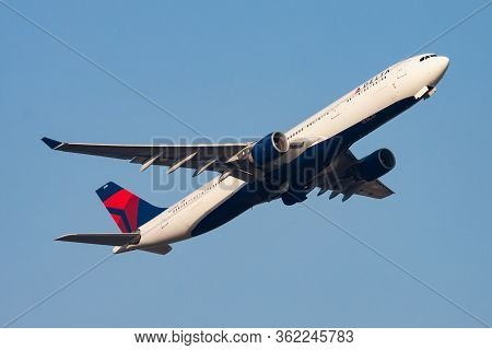 Hong Kong / China - December 1, 2013: Delta Airlines Airbus A330-300 N810nw Passenger Plane Departur