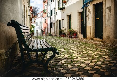 Quiet Narrow Shady Alley In The Historical Old District Of Alfama In Lisbon, Portugal, With Cobblest