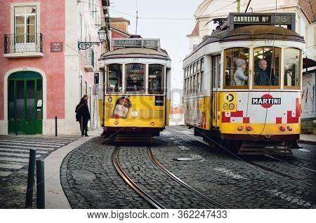 Lisbon, Portugal - February 2, 2019: Classic Traditional Yellow Trolley Tramcar In Lisbon, Portugal,