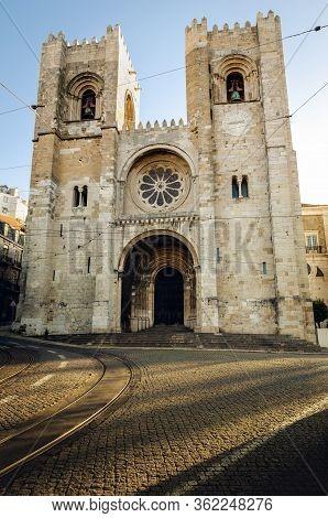 Facade Of Santa Maria Maior, Romanesque Medieval Cathedral Of Lisbon In Alfama Neighborhood In Morni