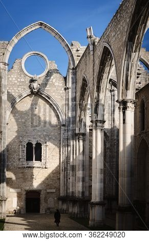Small Distant Walking Woman In The Ruins Of The Ancient Convent Of Carmo In Lisbon, Portugal, Roofle