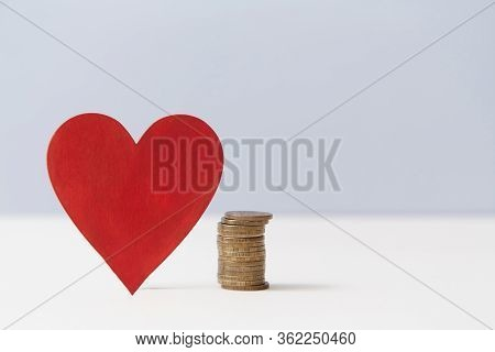 Read Heart And Stack Of Coins, Copy Space. Value Of Love. Money Vs Love Mockup For Design. Relations