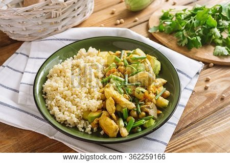 Green Plate With Chopped Chicken With Bulgur On The Side Dish, Chickpeas And Oyster Mushrooms. The D