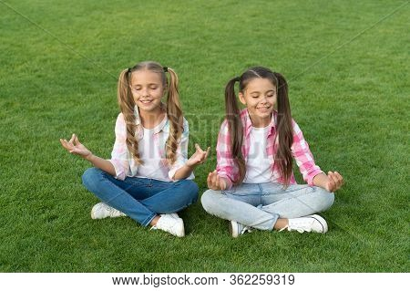 Practicing Mudras During Meditation. Happy Children Do Meditation On Green Grass. Small Girls Enjoy