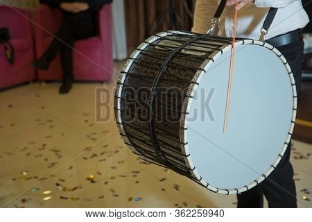 Musicians March, Play And Make Music With Large Bass Drums . Drummer Performance Musicians Play The