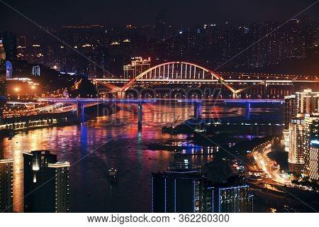 Urban buildings bridge and city skyline at night in Chongqing