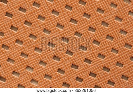 Texture Of Genuine Matte Perforated Genuine Leather Close-up, Fashion Bright Orange Color, Modern Ba