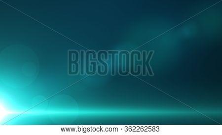 Green-blue Background With Beam Light In The Bottom Left Corner