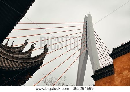 Bridge with old house and city urban architecture in Chongqing, China.