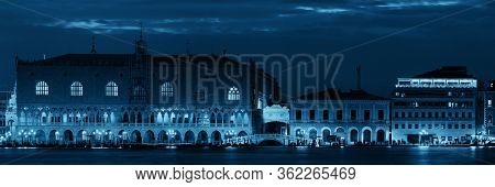 Venice skyline at night with Doge's palace and historical architectures panorama in Italy.