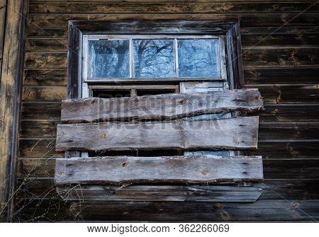 boarded up window in an old abandoned house