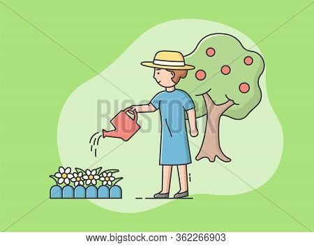 Gardening Concept. Woman Is Gardening, Watering Flowers With Watering Can. Gardener Is Working On Fl
